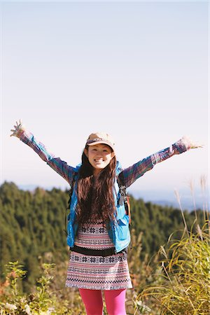 Young Woman Enjoying Nature Arm Raised Stock Photo - Rights-Managed, Code: 859-03839459