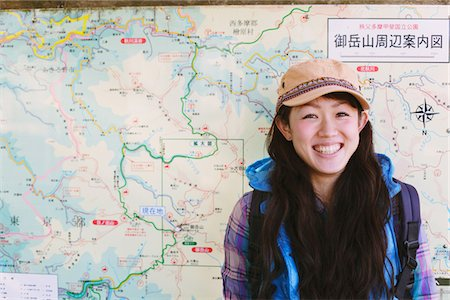 Backpack Woman Smiling Against Route Map Stock Photo - Rights-Managed, Code: 859-03839453