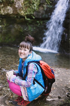 Amused Young Woman Hiker Near Waterfall Stock Photo - Rights-Managed, Code: 859-03839473