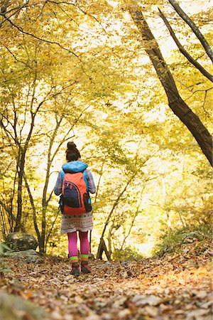 Young Woman Walking Alone In Forest Stock Photo - Rights-Managed, Code: 859-03839519