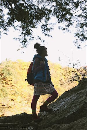 Silhouette Of Young Woman Standing On Rocks While Hiking Stock Photo - Rights-Managed, Code: 859-03839531