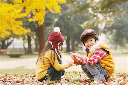 Boy And Girl Sitting In Autumn Leaves Stock Photo - Rights-Managed, Code: 859-03839633