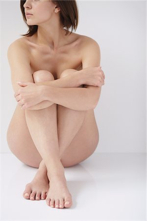 Naked Woman Hugging Knees Stock Photo - Rights-Managed, Code: 859-03839974