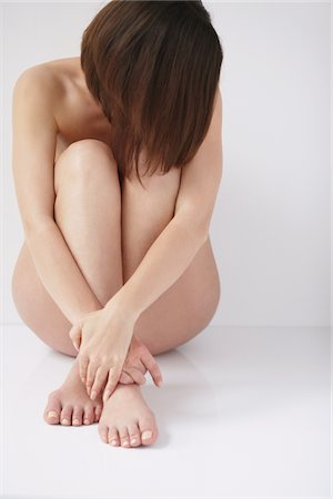 Naked Woman Hugging Knees, Head Down Stock Photo - Rights-Managed, Code: 859-03839975