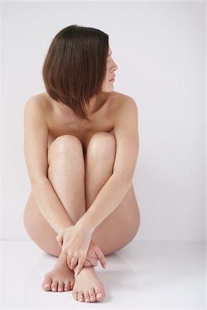 Naked Woman Hugging Knees Stock Photo - Rights-Managed, Code: 859-03839976