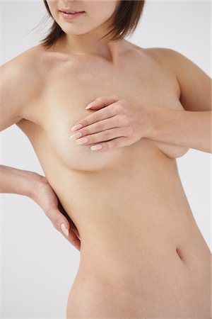 female nude breast sexy - Naked Woman Covering Her Breast Stock Photo - Rights-Managed, Code: 859-03839986