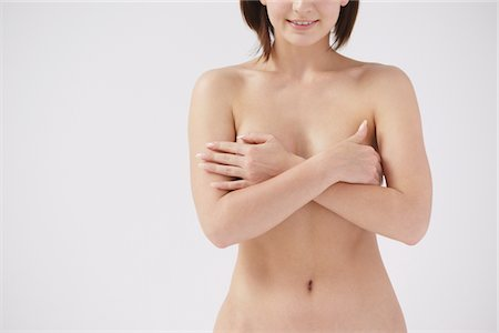 female nude breast sexy - Naked Woman Covering Her Breast Stock Photo - Rights-Managed, Code: 859-03839987