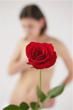 Red Rose In Front Of Nude Blurred Woman Stock Photo - Rights-Managed, Code: 859-03839989