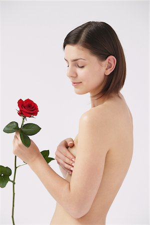 Beautiful Naked Woman Holding Red Rose Stock Photo - Rights-Managed, Code: 859-03839990