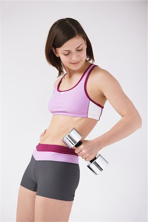 slim - Woman Lifting Weights Stock Photo - Rights-Managed, Code: 859-03840004