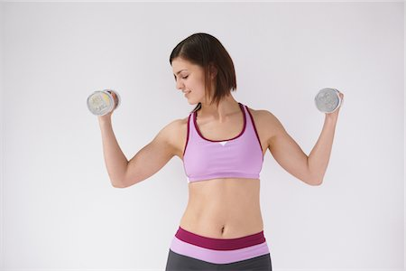 slim - Woman Lifting Weights Stock Photo - Rights-Managed, Code: 859-03840006