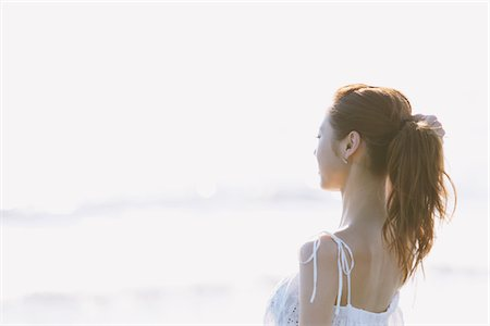 exotic outdoors - Young Woman Looking By The Sea Stock Photo - Rights-Managed, Code: 859-03840427