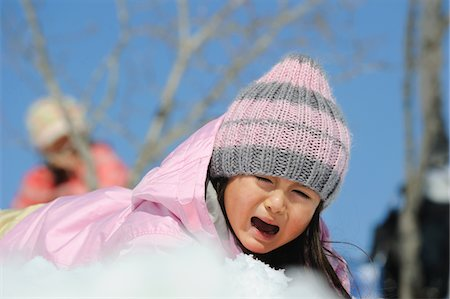 sad girls - Small Girl Fallen In Snow And Crying Stock Photo - Rights-Managed, Code: 859-03840988