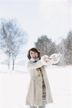 Teenage Girl Throwing Snow Stock Photo - Rights-Managed, Code: 859-03860626
