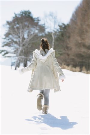 Teenage Girl Walking Alone In Snow Stock Photo - Rights-Managed, Code: 859-03860637
