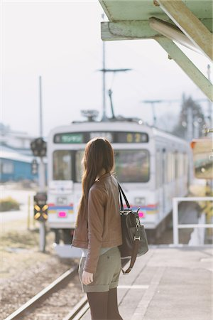 Young Woman On Platform Waiting For Train Stock Photo - Rights-Managed, Code: 859-03860700