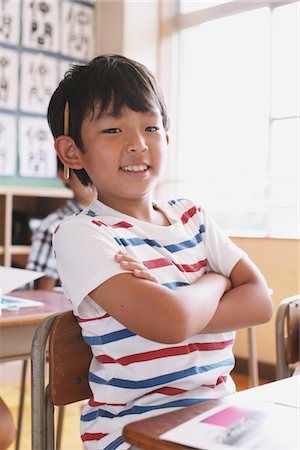 Confident Student In Classroom Arms Crossed Stock Photo - Rights-Managed, Code: 859-03860781