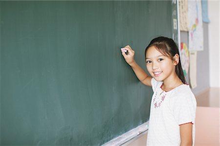 preteen girl - Schoolgirl Writing On Chalkboard Stock Photo - Rights-Managed, Code: 859-03860819