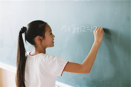 Schoolgirl Solving Math Problem Stock Photo - Rights-Managed, Code: 859-03860824