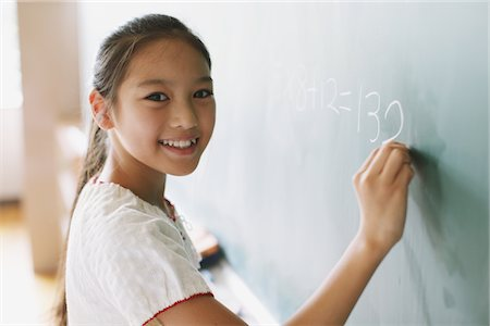 Schoolgirl Solving Math Problem Stock Photo - Rights-Managed, Code: 859-03860825