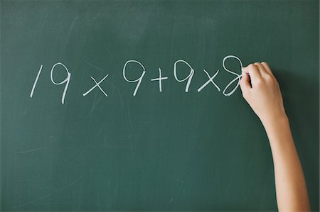 Human Hand Solving Math Problem Stock Photo - Rights-Managed, Code: 859-03860821