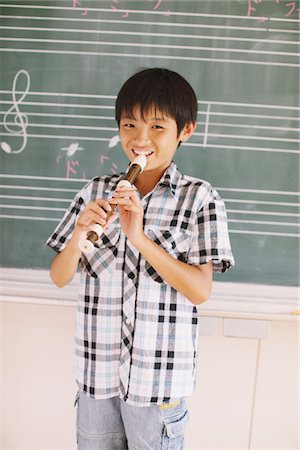 Japanese Schoolboy Playing Flute Stock Photo - Rights-Managed, Code: 859-03860844