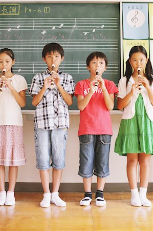 Children In Music Class Playing Flute Stock Photo - Rights-Managed, Code: 859-03860847