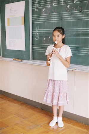Japanese Girl Playing Flute Stock Photo - Rights-Managed, Code: 859-03860840