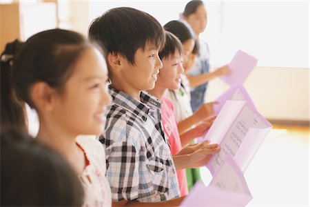 Children In Music Class Holding Note Stock Photo - Rights-Managed, Code: 859-03860850