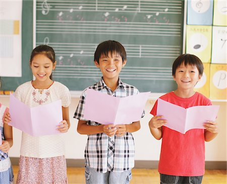 Children In Music Class Holding Note and Smiling Stock Photo - Rights-Managed, Code: 859-03860851