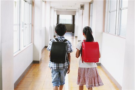 School Friends Walking Together In Corridor Stock Photo - Rights-Managed, Code: 859-03860886