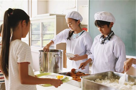 female police officer happy - Student Serving Food In Classroom Stock Photo - Rights-Managed, Code: 859-03860896