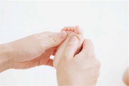 Mother Touching Baby's Foot Stock Photo - Rights-Managed, Code: 859-03982735