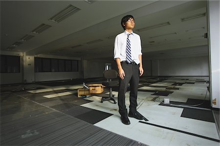 falling - Businessman Standing At Deserted Office Stock Photo - Rights-Managed, Code: 859-03983038