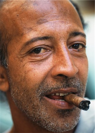 Man smoking cigar on streets,Havana,Cuba Stock Photo - Rights-Managed, Code: 851-02959347