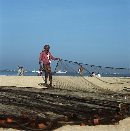 Fisherman pulling nets on the beach,Goa,India. Stock Photo - Rights-Managed, Code: 851-02960326