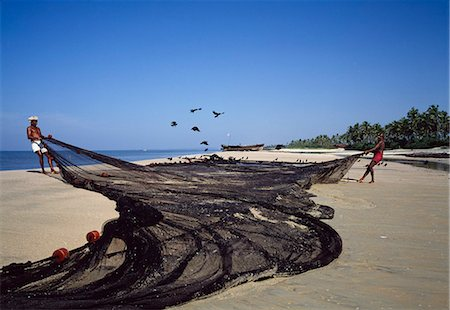 Fisherman pulling nets on the beach,Goa,India Stock Photo - Rights-Managed, Code: 851-02960327
