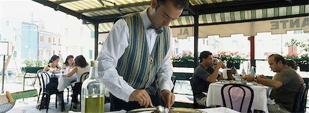 People eating at tables in restaurant.,Burano,Venice,Italy. Stock Photo - Rights-Managed, Code: 851-02960892
