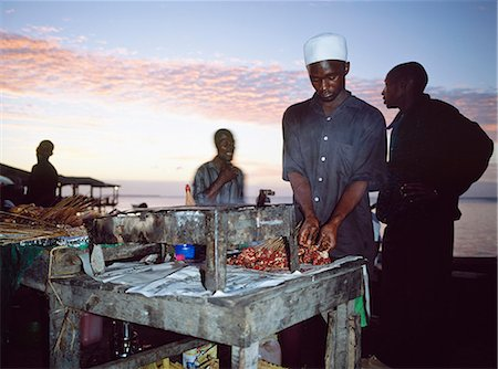 food stalls - Man cooking kebabs in sunset,Stone Town,Zanzibar,Tanzania Stock Photo - Rights-Managed, Code: 851-02963349