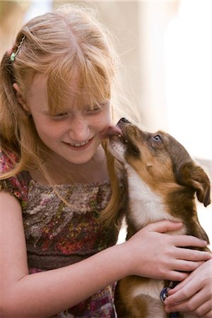 preteen girl licking - Dog licking girl's face Stock Photo - Rights-Managed, Code: 853-05523399