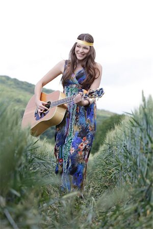 Young woman with guitar in corn field Stock Photo - Rights-Managed, Code: 853-05523737