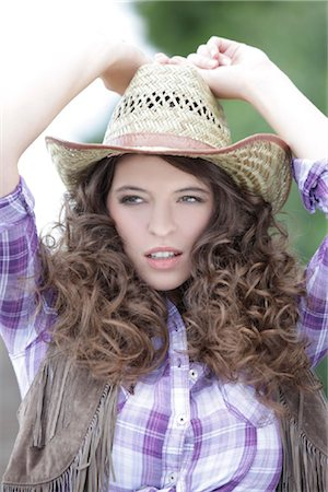 erotic female figures - Young woman as cowgirl Stock Photo - Rights-Managed, Code: 853-05523747