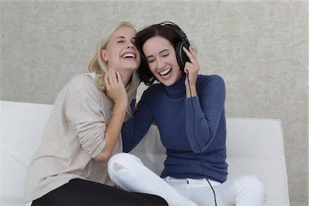 Two girl friends listening music on sofa Stock Photo - Rights-Managed, Code: 853-05841022