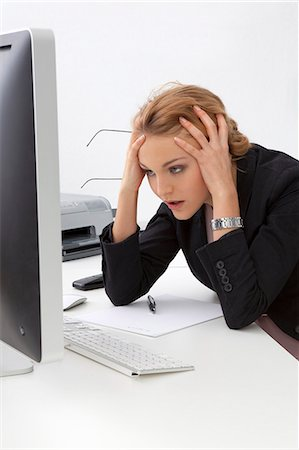 people in panic - Frustrated young woman in office Stock Photo - Rights-Managed, Code: 853-06120595