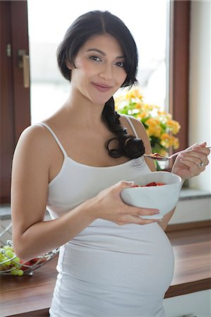 pregnant asian - Pregnant woman eating strawberries from bowl Stock Photo - Rights-Managed, Code: 853-06306061
