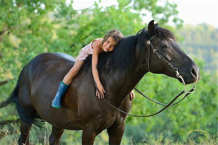 Girl lying on horse Stock Photo - Rights-Managed, Code: 853-06306082