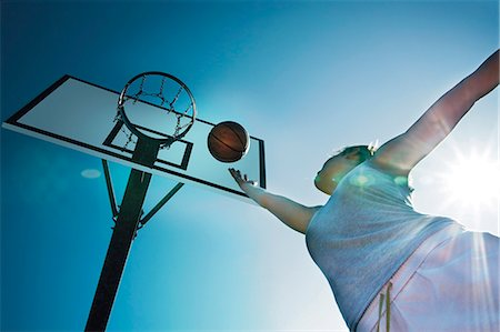 Young woman playing basketball Stock Photo - Rights-Managed, Code: 853-06441494