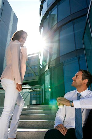 Smiling businessman and businesswoman on stairs Stock Photo - Rights-Managed, Code: 853-06441638