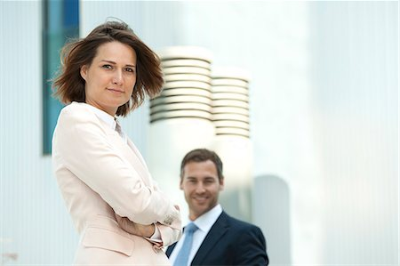 Confident businesswoman and businessman outdoors Stock Photo - Rights-Managed, Code: 853-06441680