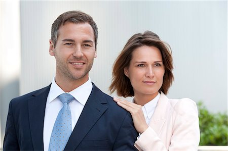 Businesswoman laying her hand on the shoulder of a businessman Stock Photo - Rights-Managed, Code: 853-06441692